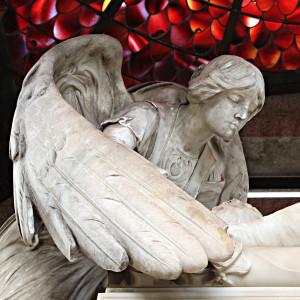 bigstock-Beautiful-sculpture-at-a-cemet-16452998